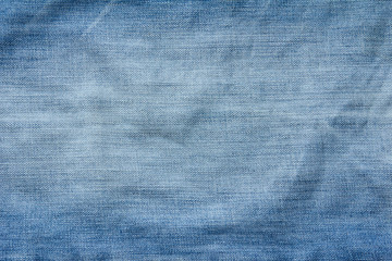 Closed up of blue creased denim jeans texture