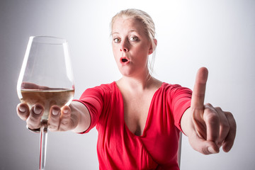 No alcohol, woman holding a glass and saying no to alcohol.