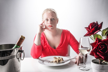Eating too much, overeating concept, woman at dinner, diet concept