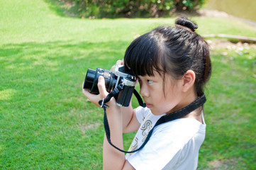 Little girl take photograph outdoor