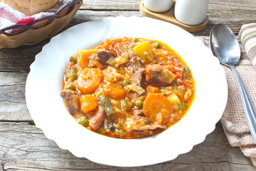 Pork meat stew with vegetables in plate