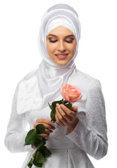 Muslim woman with rose flower