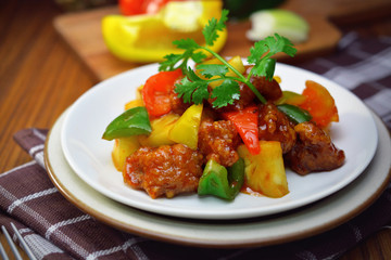 sweet and sour pork. deep fried crispy pork stir fried with pineapple and fresh capsicum, in sour and sweet sauce. worldwide famous sweet and sour pork. chinese cuisine