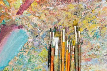 View from above of time-worn paintbrushes
