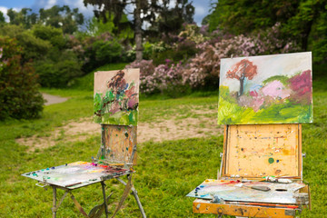 Two professional artist's sketchbooks in a park