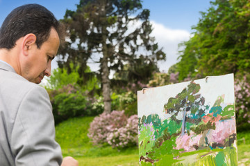 Portrait of an artist working outdoors in the park or garden