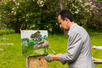 Male artist working outdoors