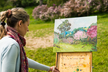 Female painter working outdoors in the park