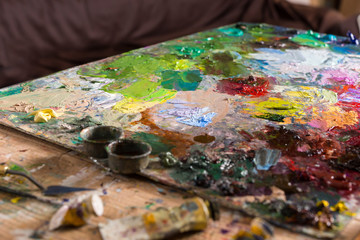 Painter's palette with oil paints