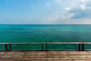 Wooden platform beside tropical sea, Old wooden bridge or wooden deck at blue sea , Wooden deck for relaxation at Koh Kood Island, Thailand