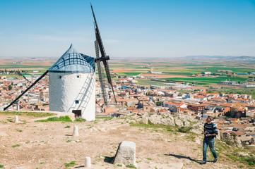 Man visiting traditional spanish windmills, Toledo, Spain
