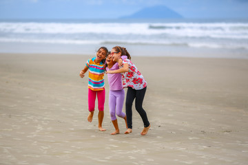 Friends playing on the beach