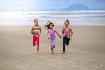 Friends running on the beach