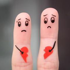 Finger art of couple. Couple holding broken heart.