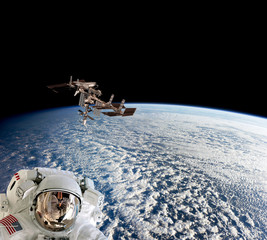 Planet Earth astronaut spaceman helmet suit outer spacewalk international space station. Elements of this image furnished by NASA.