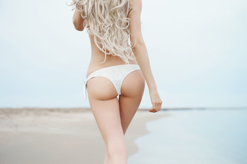 Beautiful slender blonde at the sea