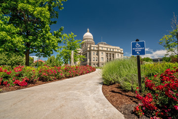 State capital and wheel chair access sign