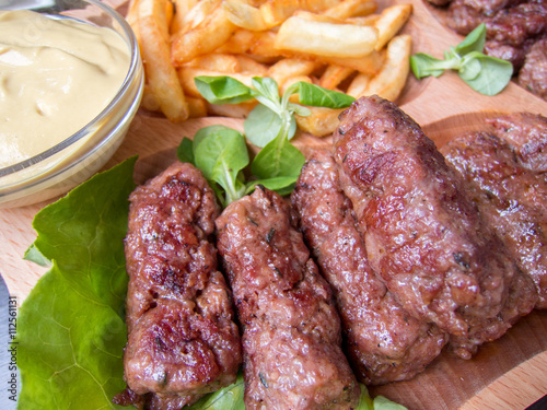 Fototapete romanian traditional food meat rolls mici with fries and mustard
