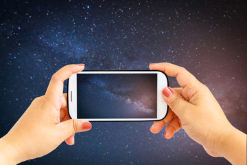 Smartphone photographing milky way galaxy with stars and space dust in the universe