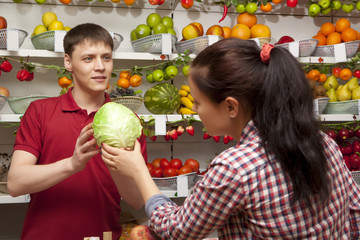 Young woman buys cabbage