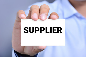 SUPPLIER word on the card shown by a man