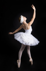 Ballerina  is dancing on a black background