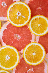Orange and grapefruit rings background