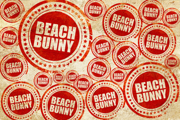 beach bunny, red stamp on a grunge paper texture
