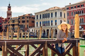 Portrait of lovely girl on the pier in Venice, Italy