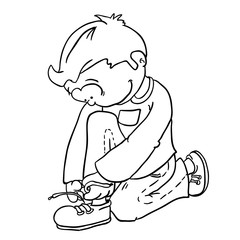 black and white boy tying a shoelace