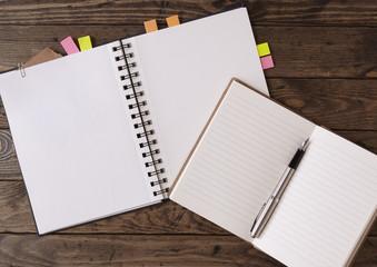 Notebooks on a wooden desktop