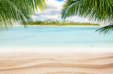 Sandy tropical beach with island on background Wall mural