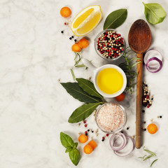 Wooden spoon and ingredients on marble background