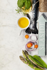 Raw rainbow trout with vegetables, herbs and spices