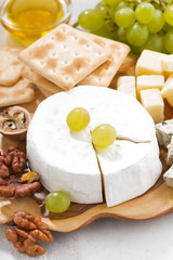 camembert, grapes and crackers, vertical closeup