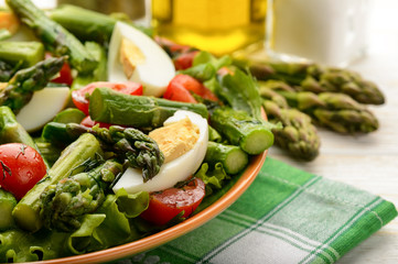 Delicius salad with green asparagus, tomatoes and eggs.