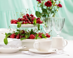 Summer. Table setting. Berries - strawberries and cherries at a