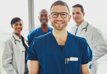Doctor leading medical team at hospital