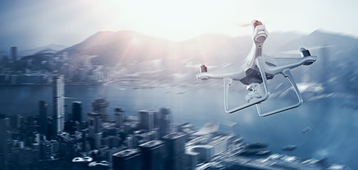Photo White Matte Generic Design Remote Control Air Drone with action camera Flying Sky under City. Modern Megapolis Background. Wide, side angle view. Motion blur Effect. 3D rendering.