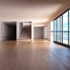 Raum mit Holzfußboden und Treppe an der See