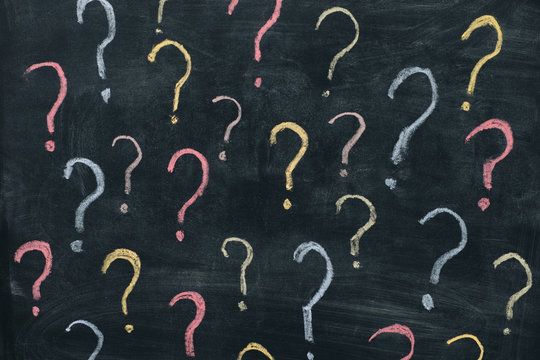 Colorful question marks on chalkboard background