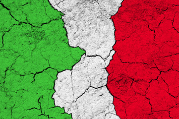 Flag of Italy on rugged wall full of scratches - metaphor of problem and crisis leading to collapse of country - economical bankruptcy, migration crisis