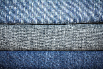 Blue denim jeans texture. blue jean fabric texture. Jeans background. Texture of blue jeans textile close up with copy space for text or image. Dark edged.
