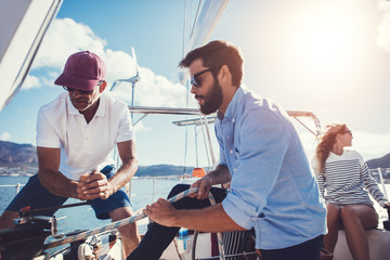 Two men preparing to set sail on yacht