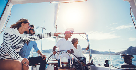 Group of people traveling in a yacht on a summer day