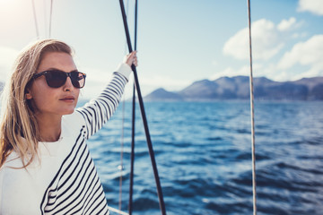 Beautiful young woman on boat trip