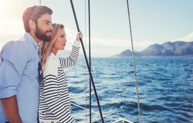 Young couple enjoying the view from a sailboat.