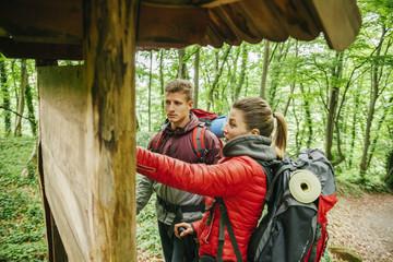 Serbia, Rakovac, young couple hiking