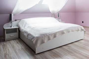 Pink bedroom with double bed