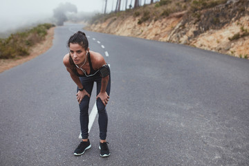 Fitness woman taking a break during the running workout